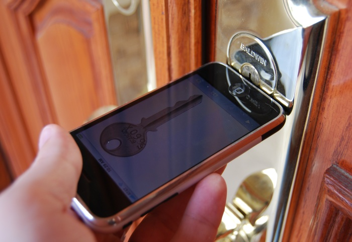 iPhone unlocking a door